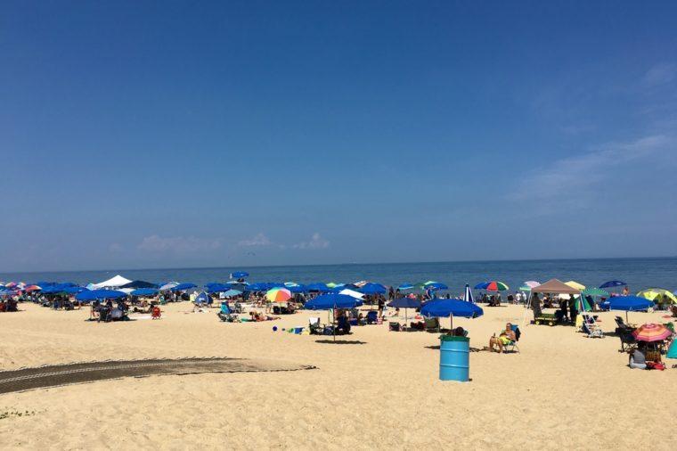REHOBOTH BEACH, DE - JULY 31, 2016: People enjoying a warm summer day at Rehoboth Beach. Rehoboth beach is a popular beach in Delaware.