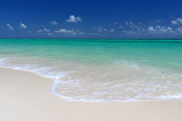 The pristine sands and crystal clear waters of Cable Beach, Nassau in the Bahamas.