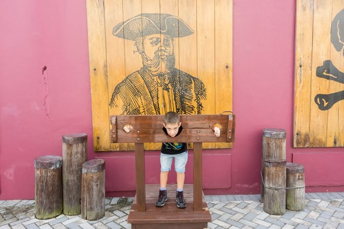 NASSAU, BAHAMAS - OCT 15, 2016: People in the Pirates of Nassau Museum, a small museum documenting the city's history as 18th-century pirate base, with replica pirate ship & exhibits.