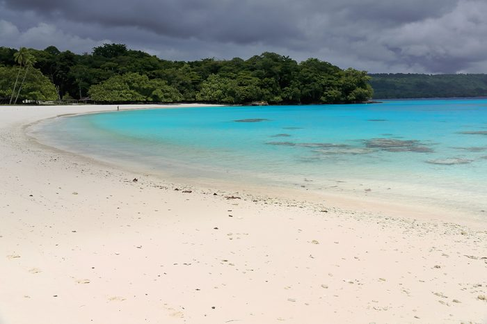 On the white sands and blue-green waters of Champagne beach in Hog Harbour bay closed on the N.by Elephant island the Americans celebrated the end of W.W.II. Espiritu Santo island-Sanma prov.-Vanuatu.