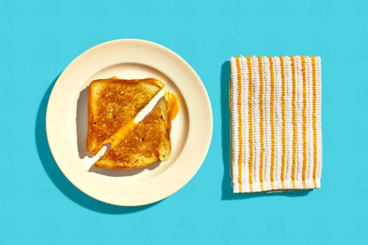 Grilled Cheese Sandwich on a Plate on a Blue Background