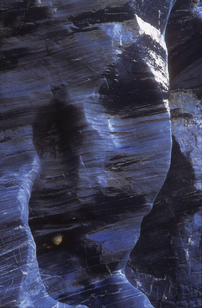 The woman in the rocks Tregardock Beach Cornwall