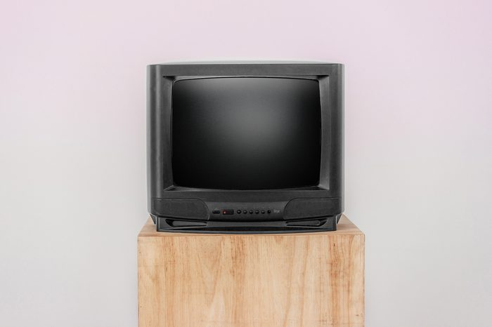Old TV with OFF screen on a wooden shelf, Isolated background