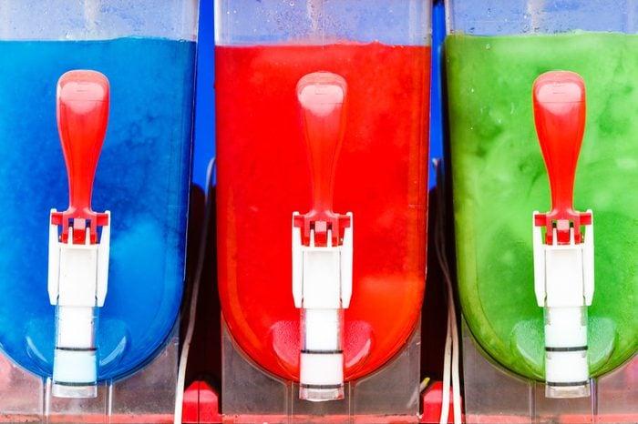 Food, cold sweet desert, summertime pleasure concept. Colorful ice cream slushy smoothie machine