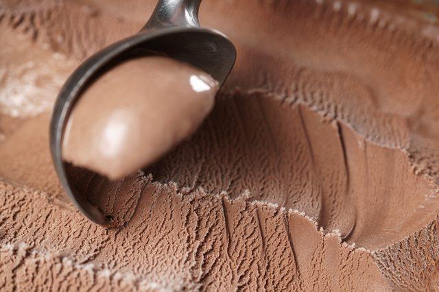 scooping chocolate ice cream close up shot, shallow focus