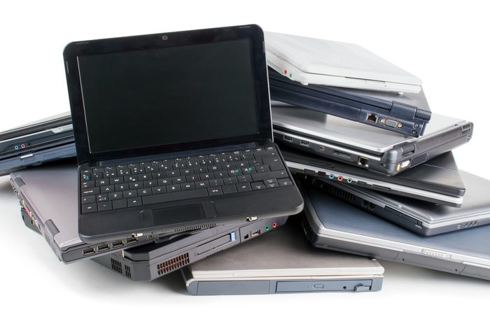 Stack of used laptops for recycle , white background
