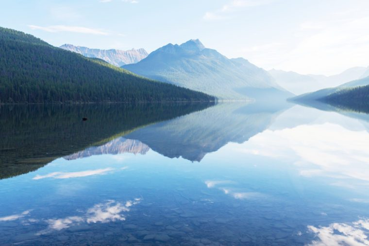 Beautiful Bowman lake with reflection of the spectacular mountains in Glacier National Park, Montana, USA. Instagram filter.