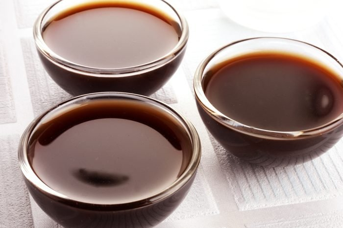 THREE GLASS BOWLS FILLED WITH WORCESTER SAUCE