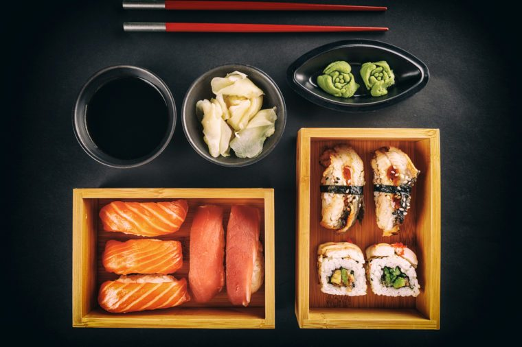 Sushi Set: sushi and sushi rolls on black background, top view
