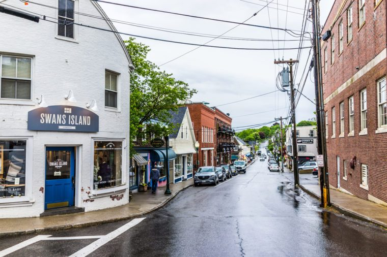 Camden, USA - June 9, 2017: Downtown small village in Maine during rain with stores on empty street