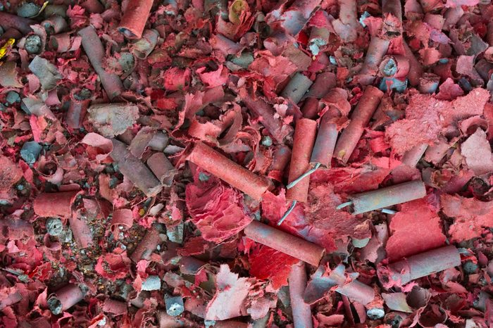 The debris caused by the explosion of the firecrackers are stacking resulted in dirty places.