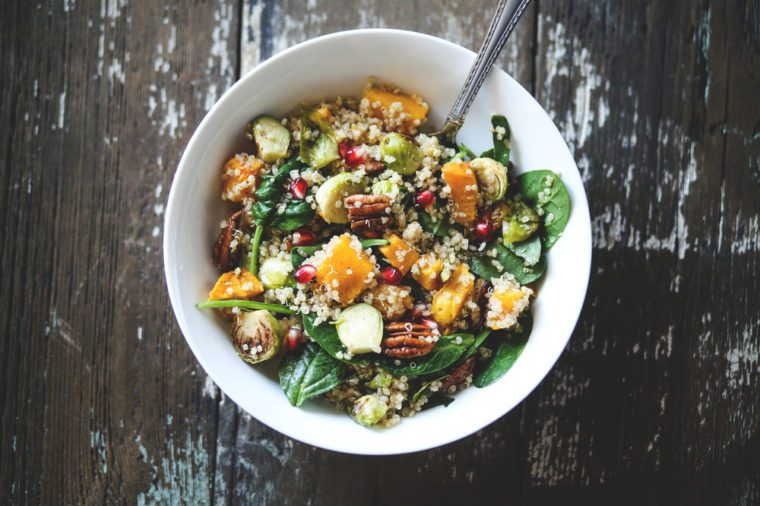 Vegan fall salad with squash, brussels sprouts, and pomegranate seeds