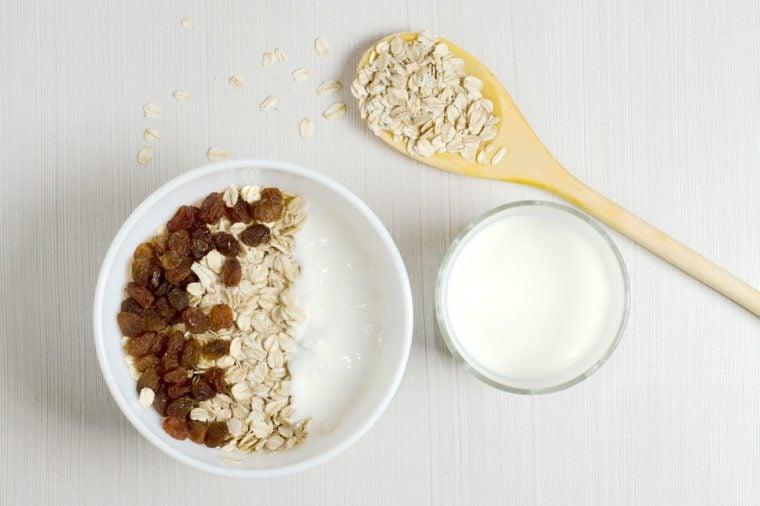 Oatmeal with raisins and yogurt.