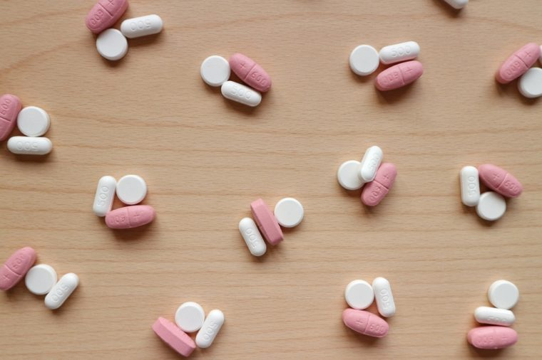 Pills medicine as group decorated on wood table