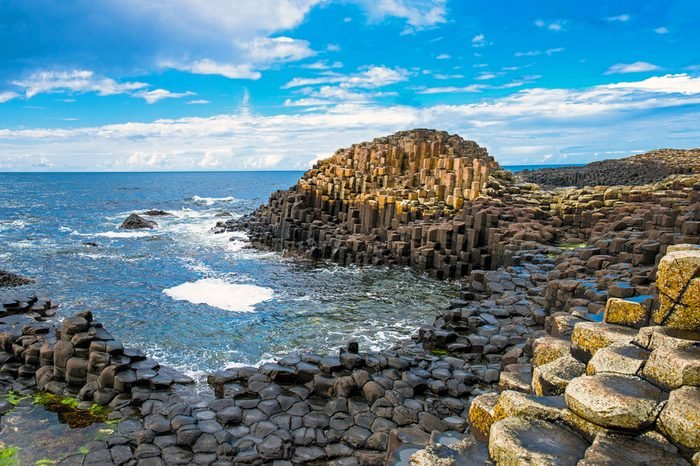 Landscape of Giant's Causeway trail with a blue sky in summer in Northern Ireland in United Kingdom. UNESCO heritage.