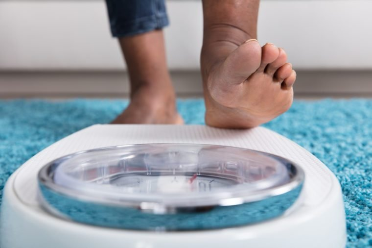 Close-up Of A Human Foot Stepping On Weighing Scale