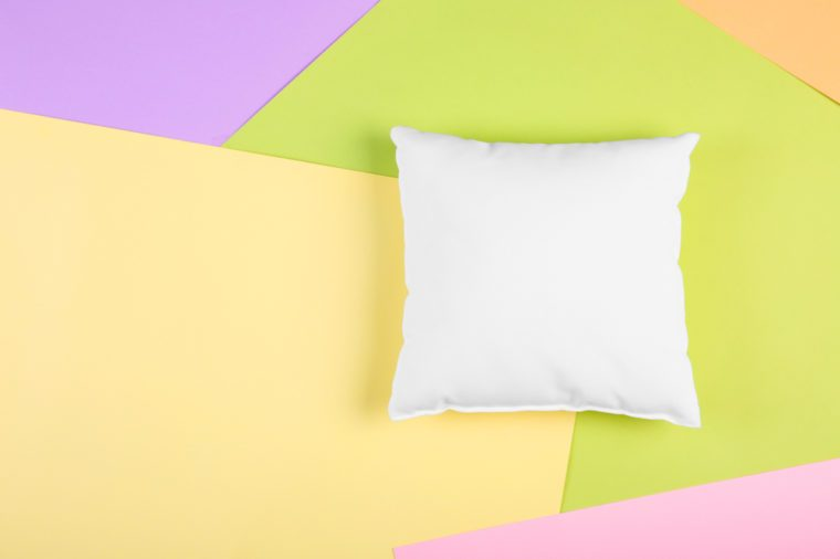 Blank soft pillow on color background