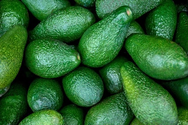 fresh avocado on the market. avocados are very nutritious and contain a wide variety of nutrients.