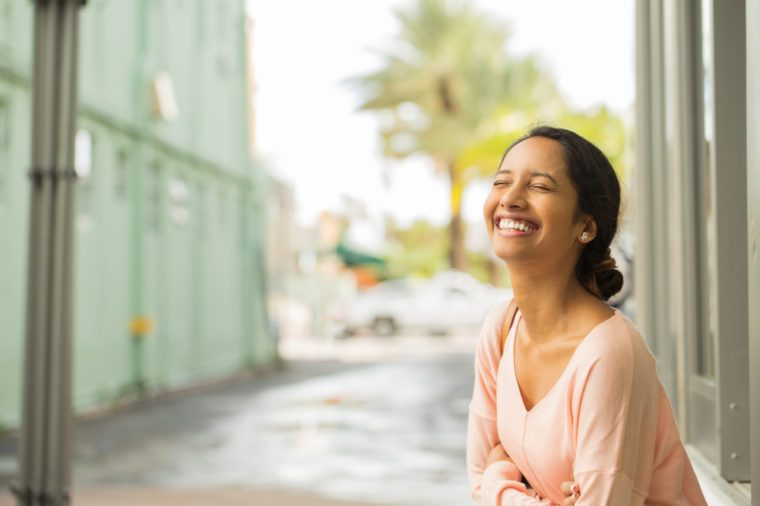 Young beautiful woman smiling and laughing.