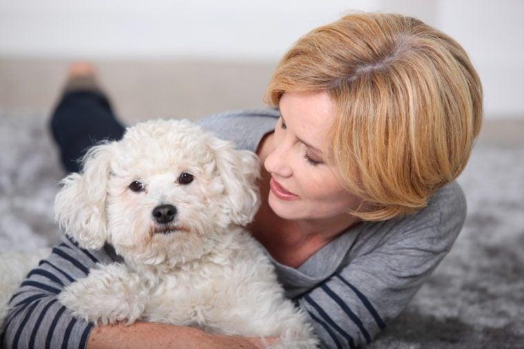 beautiful woman holding a little dog