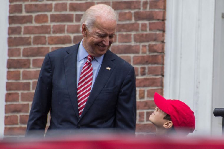 Vice President Joe Biden smiles at a young family member before speaking at the Celebration of Freedom event in Philadelphia, Friday, July 4, 2014.