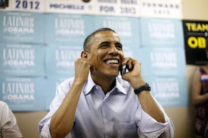 Barack Obama President Barack Obama uses a cell phone to call supporters during a visit to a local campaign office, in Henderson, Nev