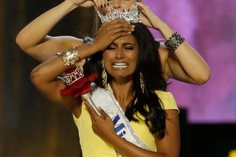 Mallory Hagan, Nina Davuluri. Miss New York Nina Davuluri, front, is crowned as Miss America 2014 by Miss America 2013 Mallory Hagan, in Atlantic City, N.J