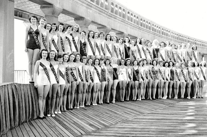 These women line the boardwalk at Atlantic City, N.J.,, where they are competing for the title of Miss America, 1952. The annual beauty pageant ends Sept. 8. Three of this group (front, center), Miss Sweden, Miss America 1951, and Miss Atlantic City, are not contestants