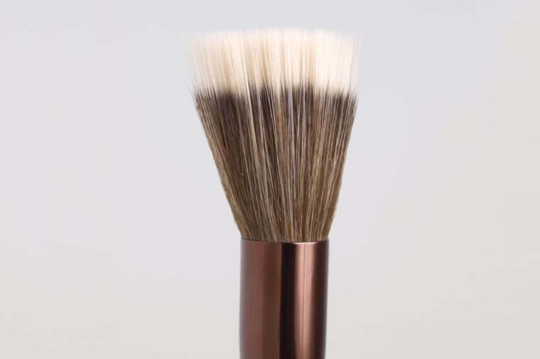 Stippling brush for make-up isolated on grey