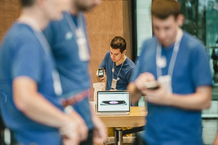 STRASBOURG, FRANCE - SEPTEMBER 19, 2014: A sales assistant scans new Apple iPhone 6 phones boxes at the Apple Store on the first day of sales of the new smart phone on September 19, 2014