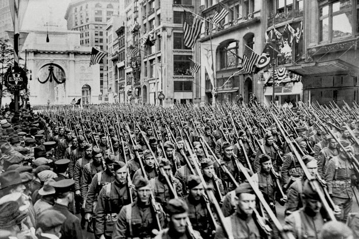 """The First Battalion of he 308th Infantry, the famous """"Lost Battalion"""" of the 77th Division's Argonne campaign of the Great War, march up New York's Fifth Avenue just past the Arch of Victory during spring of 1919"""