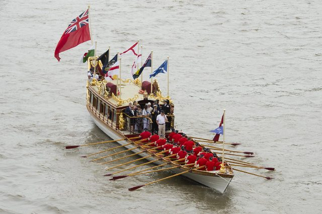 The River Pageant to Mark the Queen's offical 90th Birthday The Queen's Row Barge 'Gloriana' leads the pageant upriver