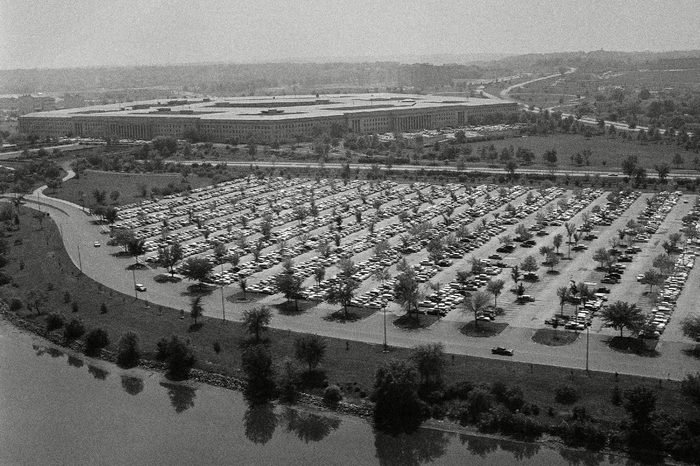 View of the grounds showing parked cars around the Pentagon building (in background) in Arlington, Virginia on