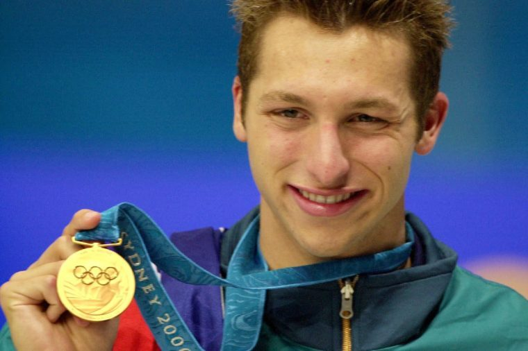 THORPE Australian swimmer Ian Thorpe holds his gold medal from the men's 400m freestyle, at the Sydney International Aquatic Centre during the Summer Olympics in Sydney. Thorpe bested his previous world record with a time of 3:40:59