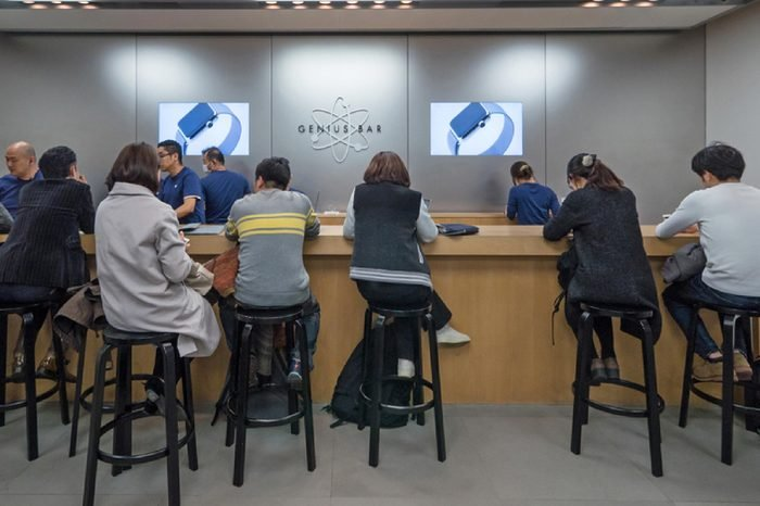 TOKYO, JAPAN - CIRCA MARCH, 2017: Customers at Genius bar inside Apple Store. Apple Inc. is an American multinational technology company headquartered in Cupertino, California.