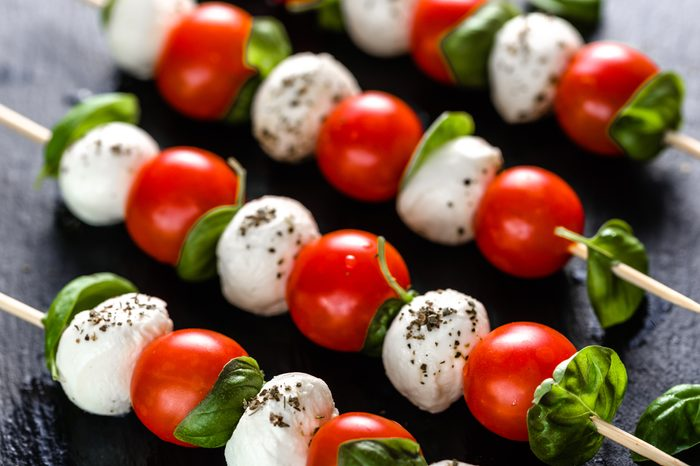 Italian food - caprese salad with tomato, mozzarella and basil, mediterranean diet and weight loss concept
