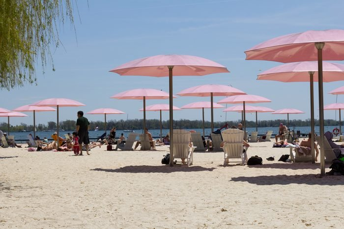 TORONTO, CANADA - 25TH MAY 2014: Part of Sugar Beach facing towards the Islands, showing people enjoying the warm weather