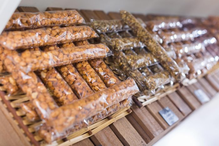 Image of showcase with dried fruits and nuts in container in the store.