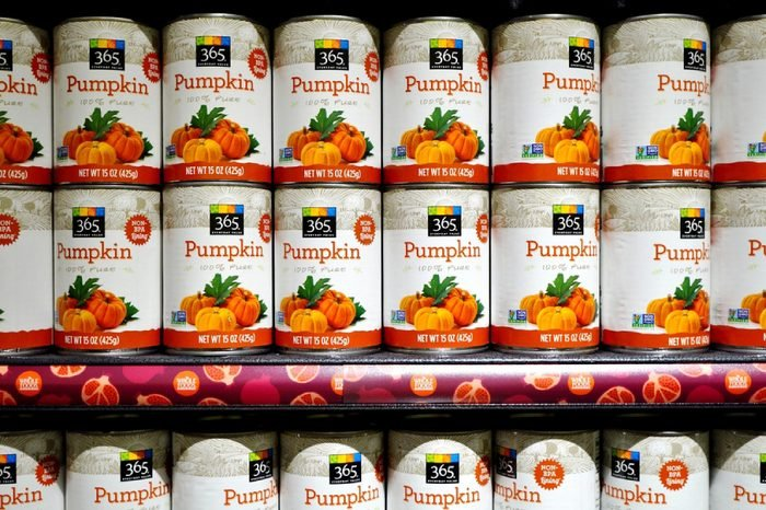 WEST WINDSOR, NJ -10 NOVEMBER 2015- Cans of pumpkin puree lined up on the shelf from 365, the low cost brand of Whole Foods Market.