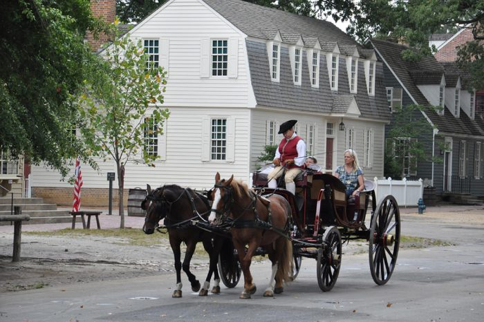 WILLIAMSBURG, VA - SEP 6: Horse-drawn carriage rides in Williamsburg, Virginia, on Sep 6, 2015. Colonial Williamsburg is a living-history museum with exhibits of restored or re-created buildings.