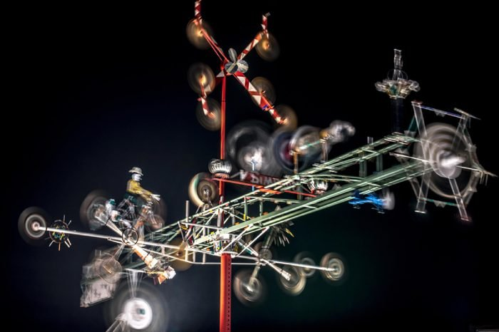 WILSON, NC - FEBRUARY 2, 2017: Whirlgigs spin at night in the Vollis Simpson Whirligig Park in Wilson, NC. The whirligigs are a restoration project celebrating the folk art of the late Vollis Simpson.