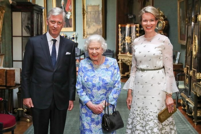 Queen Elizabeth II stands with The King and Queen of the Belgians, Philippe of Belgium (left) and Queen Mathilde (right) in the Grand Corridor during their audience at Windsor Castle