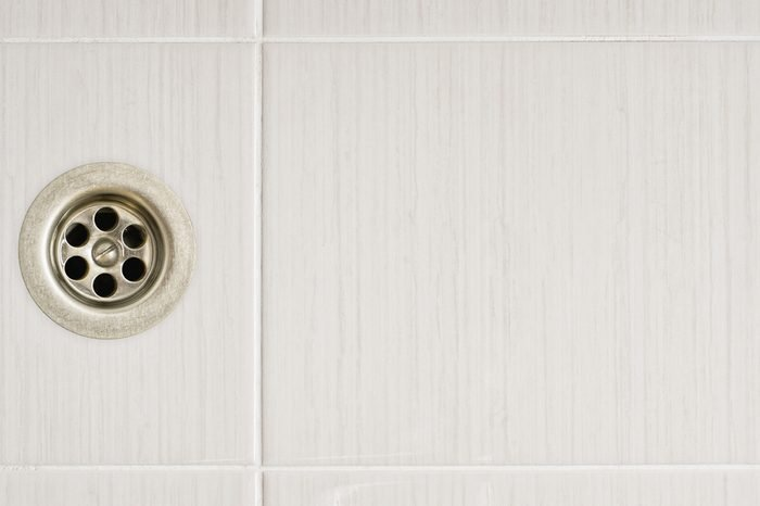 The shower drain with tile floors