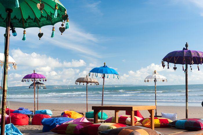 Colorful beach umbrellas and pillows in Kuta, Bali
