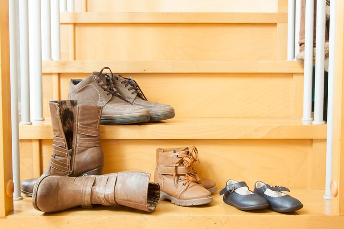 Autumn shoes on stairs in house