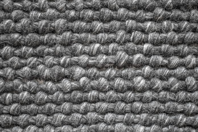 Close up of a wool carpet. Black and White texture. Modern design.