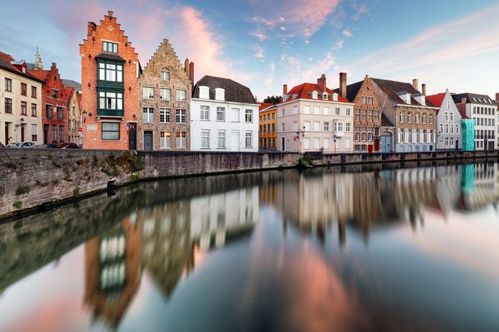 Bruges canals, Spiegelrei with reflection old houses at sunset. Belgium
