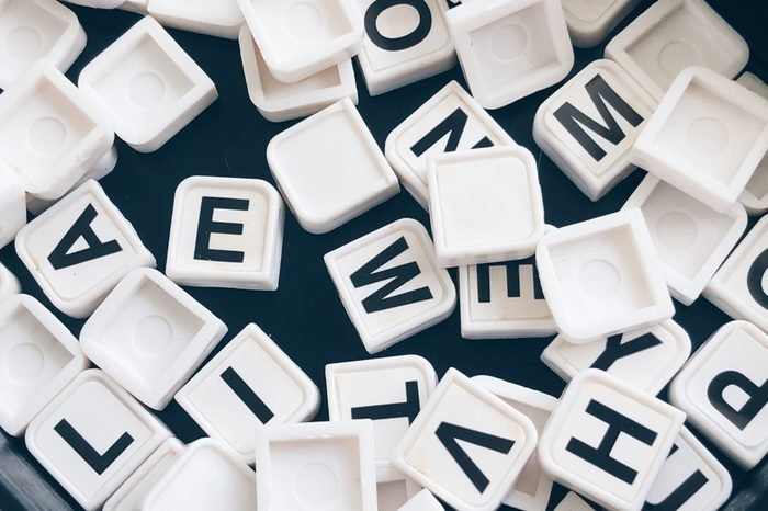 Assorted letter tiles jumbled up in a pile