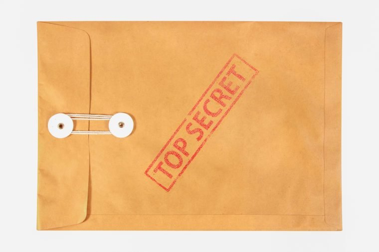 Stamp top secret on the brown envelop file ,isolated on white background