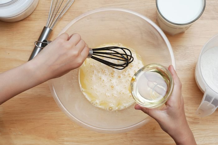 Cooking with Kids. Girl Hand Mixing Ingredient Cook Muffin Dough Wooden Table